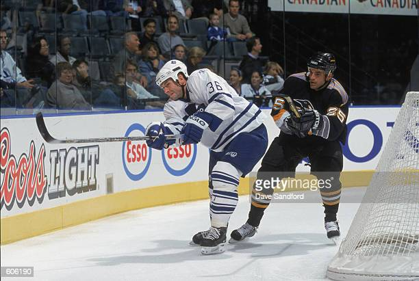 Defenseman Dimitry Yushkevich of the Toronto Maple Leafs battles with left wing Kevin Stevens of the Pittsburgh Penguins during the NHL game at Air...