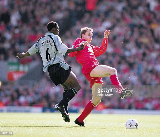 Dietmar Hamann of Liverpool battles with George Boateng of Aston Villa during the FA Barclaycard Premiership match played at Anfield in Liverpool...