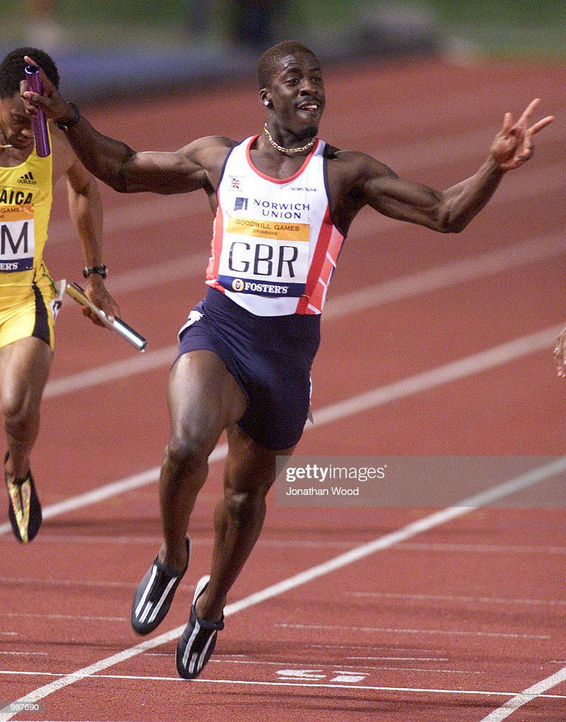 Dwain Chambers of Great Britain celebrates winning the Mens 4 x 100 Metres Relay during the athletics at the ANZ Stadium during the Goodwill Games in Brisbane, Australia. DIGITAL IMAGE Mandatory Credit: Jonathan Wood/ALLSPORT