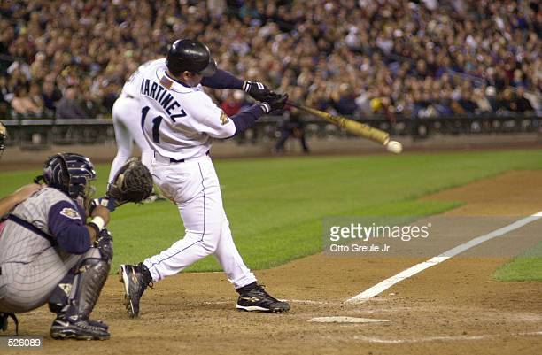 Edgar Martinez of the Seattle Mariners delivers a hit against the Anaheim Angels during the game at Safeco Field in Seattle Washington The Mariners...