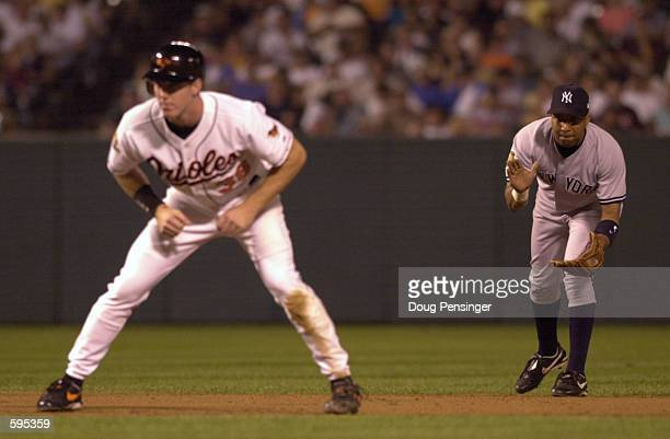 Enrique Wilson shortstop for the New York Yankees tries to distract baserunner Chris Richard of the Baltimore Orioles at Oriole Park at Camden Yards...