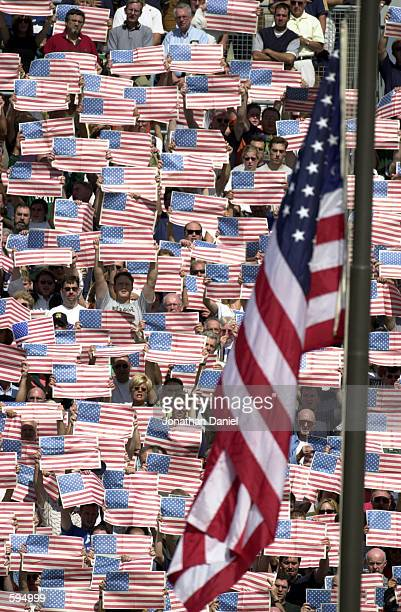 Fans at Notre Dame Stadium hold American flags during the National Anthem before Notre Dame takes on Michigan State at South Bend, Indiana. DIGITAL...