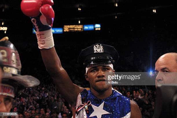 Felix Trinidad enters the ring wearing a NYPD hat before his fight against Bernard Hopkins for the middleweight championship unification fight at...