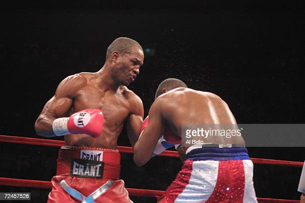 Felix Trinidad is hit by a hook thrown by Bernard Hopkins during their middleweight championship unification fight at Madison Square Garden in New...