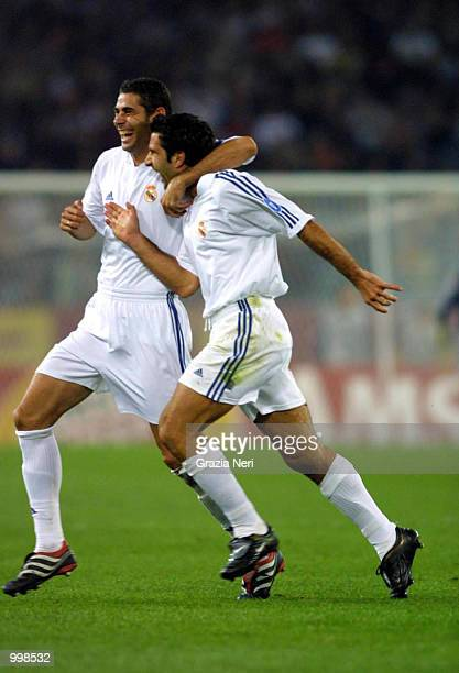 Fernando Hierro and Luis Figo of Real Madrid celebrate during the Champions League match played at the Olympic stadium in Rome Italy Real Madrid won...