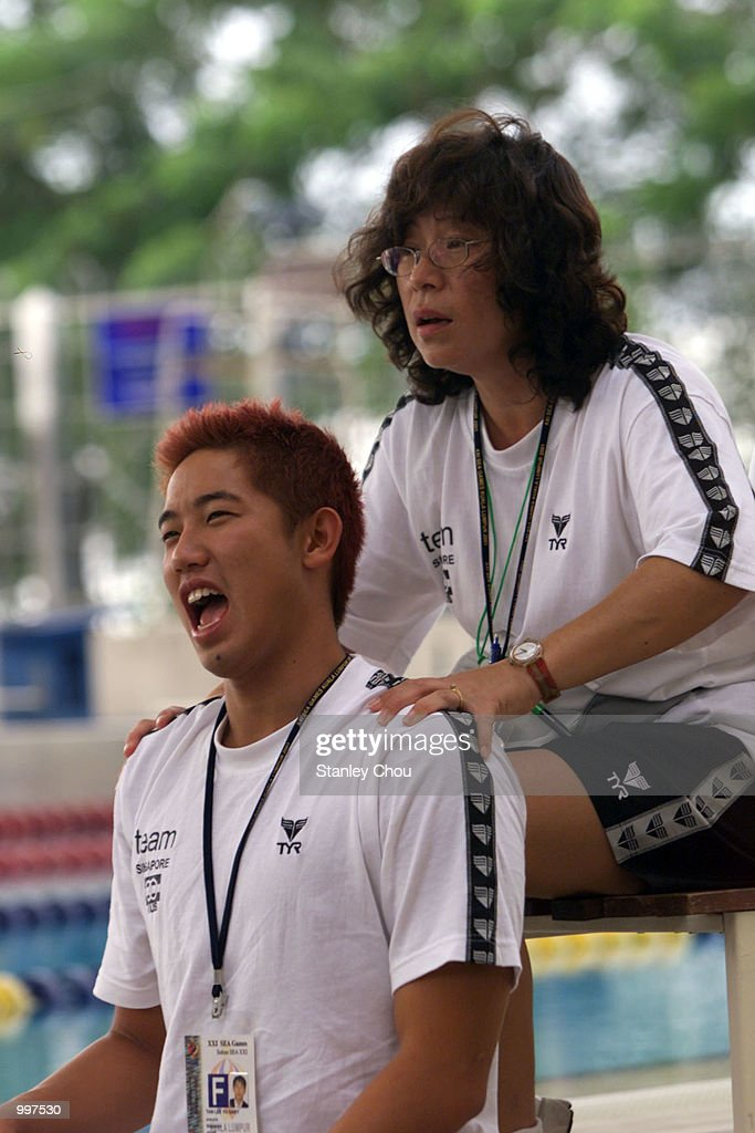 Gary Tan of Singapore gets a massage from the Team's Physio before the start of a training session being held at the Bukit Jalil Aquatics Centre, Kuala Lumpur, Malaysia ahead of the 21st South East Asian Games which will begin from 8 September to 17 September 2001. DIGITAL IMAGE. Mandatory Credit: Stanley Chou/ALLSPORT