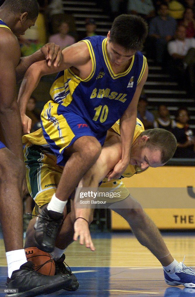 Glen #7 (right) of Australia battles with Helio Garcia Filho #10 of Brazil as Brazil defeats Australia to win the bronze medal in the Mens Basketball held at the Brisbane Convention and Exhibition Centre at the Goodwill Games in Brisbane,Australia. DIGITAL IMAGE. Mandatory Credit: Scott Barbour/ALLSPORT