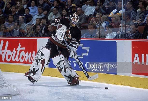 Goaltender Robert Esche of the Phoenix Coyotes passes the puck during the preseason game against the Vancouver Canucks at the GM Place in Vancouver...