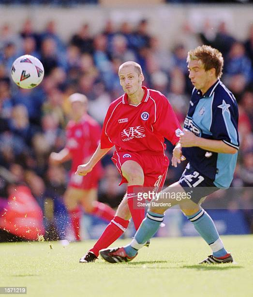 Graham Hyde of Chesterfield shoots round Darren Currie of Wycombe during the Nationwide Division Two match between Wycombe Wanderers and Chesterfield...