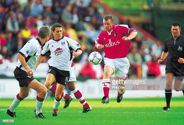 Graham Stuart of Charlton takes on Fulham's John Collins and Kit Symons during the FA Barclaycard Premiership match between Charlton Athletic and...