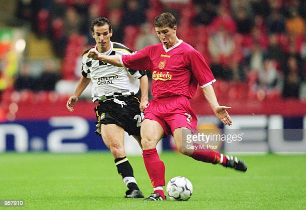 Gregory Vignol of Liverpool is closely followed by Petit of Boavista during the UEFA Champions League match between Liverpool and Boavista played at...