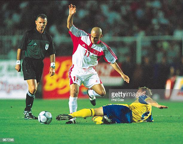 Hasan Sas of Turkey is tackled by Tobias Linderoth during the FIFA 2002 World Cup Qualifier between Turkey and Sweden played at the Ali Sami Yen...