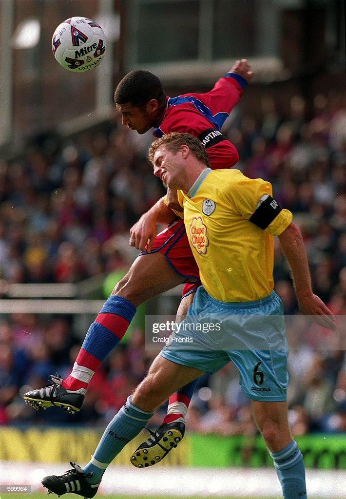Hayden Mullins of Crystal Palace clashes with Trond-Egil Solvegt of Sheffield Wednesday during the Nationwide League Division One match between Crystal Palace and Sheffield Wednesday played at Selhurst Park, London. Mandatory Credit: CraigPrentis/ALLSPORT