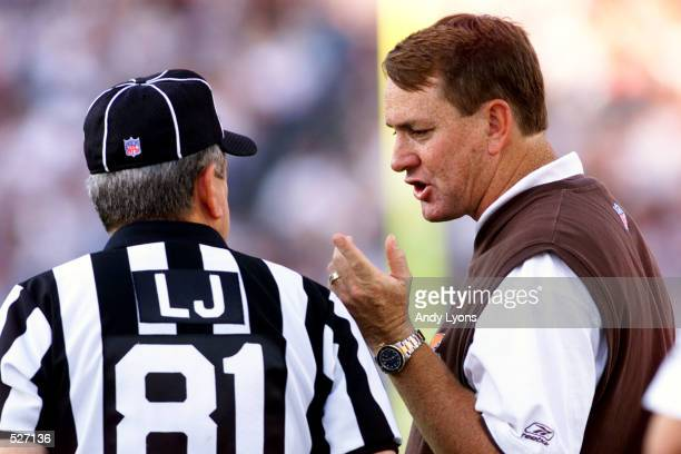 Head coach Butch Davis of the Cleveland Browns talks with referee Dave Anderson in the Browns game versus the Jacksonville Jaguars at Alltel Stadium...