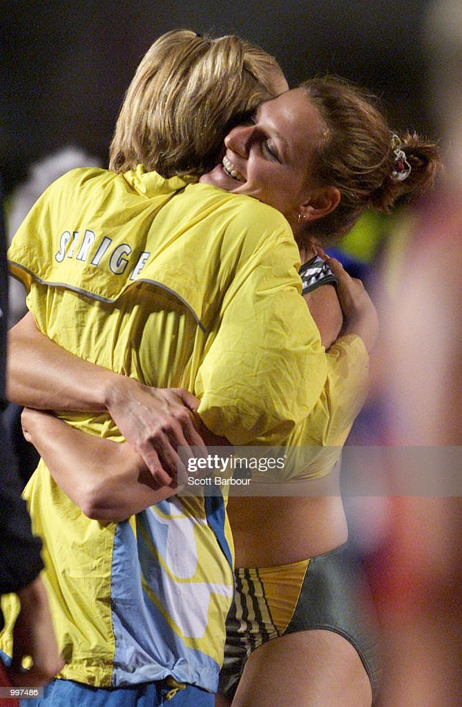 Hestrie Cloete of South Africa (right) embraces Silver medalist Kajsa Bergqvist of Sweden as she celebrates the Gold medal with a jump of two metres during the Womens High Jump during the athletics at the ANZ Stadium during the Goodwill Games in Brisbane, Australia. DIGITAL IMAGE Mandatory Credit: Scott Barbour/ALLSPORT