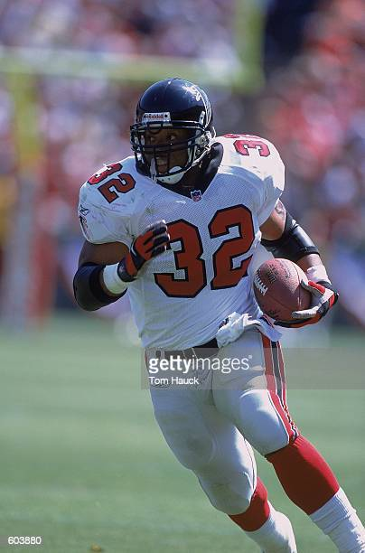 Jamal Anderson of the Atlanta Falcons running with the ball during the game against the San Francisco 49ers at 3Com Park in San Francisco California...