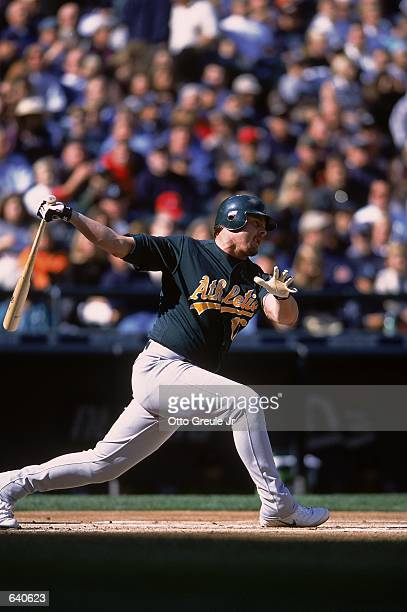 Jeremy Giambi of the Oakland Athletics hits the ball during the game against the Seattle Mariners at Safeco Field in Seattle Washington The Mariners...