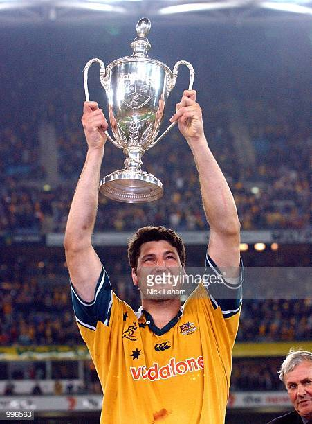 John Eales of the Wallabies holds the Tri Nations trophy aloft after victory in the Tri Nations rugby union match between the Australian Wallabies...