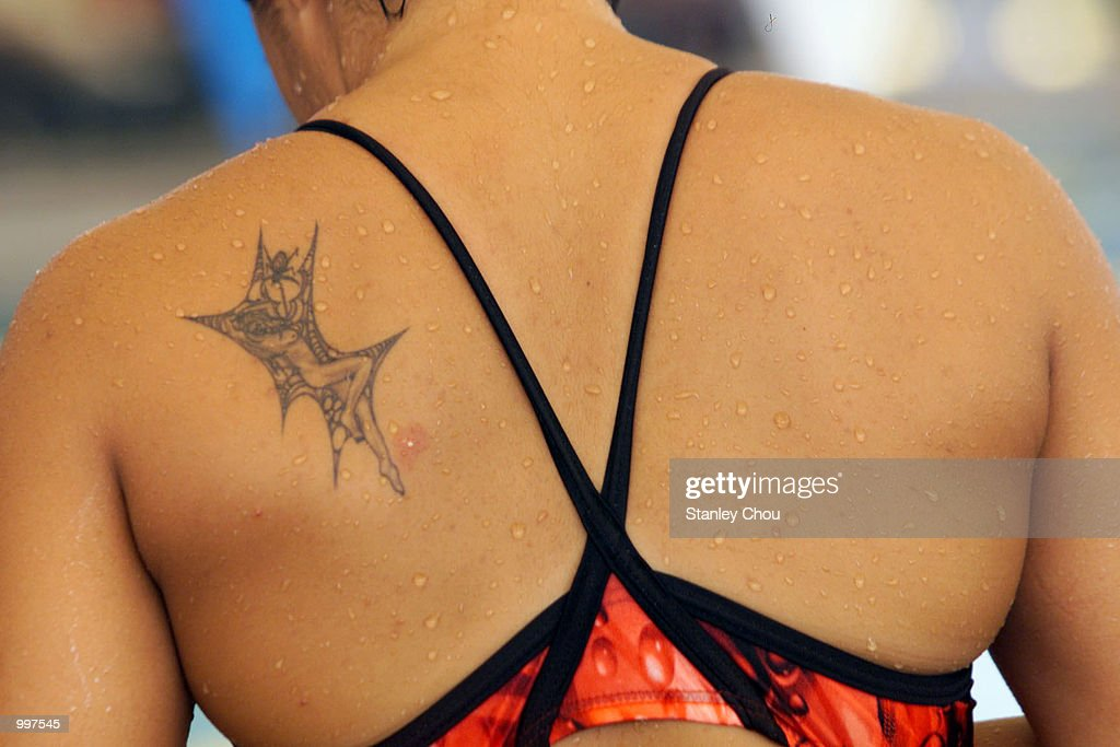 Joscelin Yeo of Singapore spots a Tattoo at her back during a training session held at the Bukit Jalil Aquatics Centre, Kuala Lumpur, Malaysia ahead of the 21st South East Asian Games which will begin from 8 September to 17 September 2001. DIGITAL IMAGE. Mandatory Credit: Stanley Chou/ALLSPORT