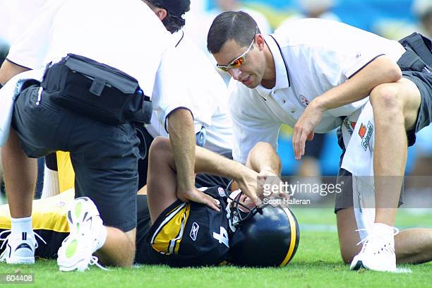 Josh Miller of the Pittsburgh Steelers is attended to by trainers during the game against the Jacksonville Jaguars at Alltel Stadium in Jacksonville...