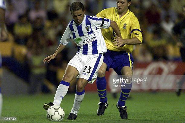 Josico of Las Palmas and Sandro of Malaga in action during the Primera Liga match between Las Palmas v Malaga at the Insular Stadium Las Palmas de...