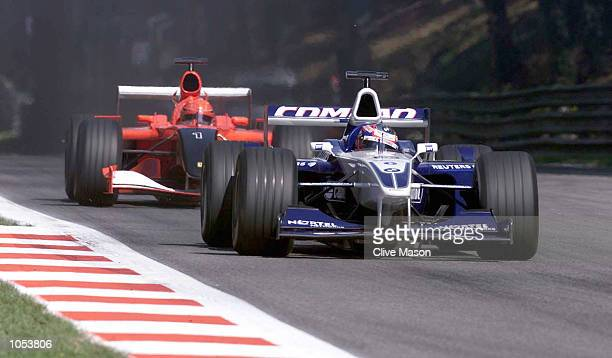 Juan Pablo Montoya of Columbia and BMW Williams ahead of Michael Schumacher of Germany and Ferrari during the Italian Grand Prix at Monza Italy...