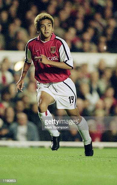 Junichi Inamoto of Arsenal in action during the UEFA Champions League Group C match against Schalke 04 played at Highbury in London Arsenal won the...