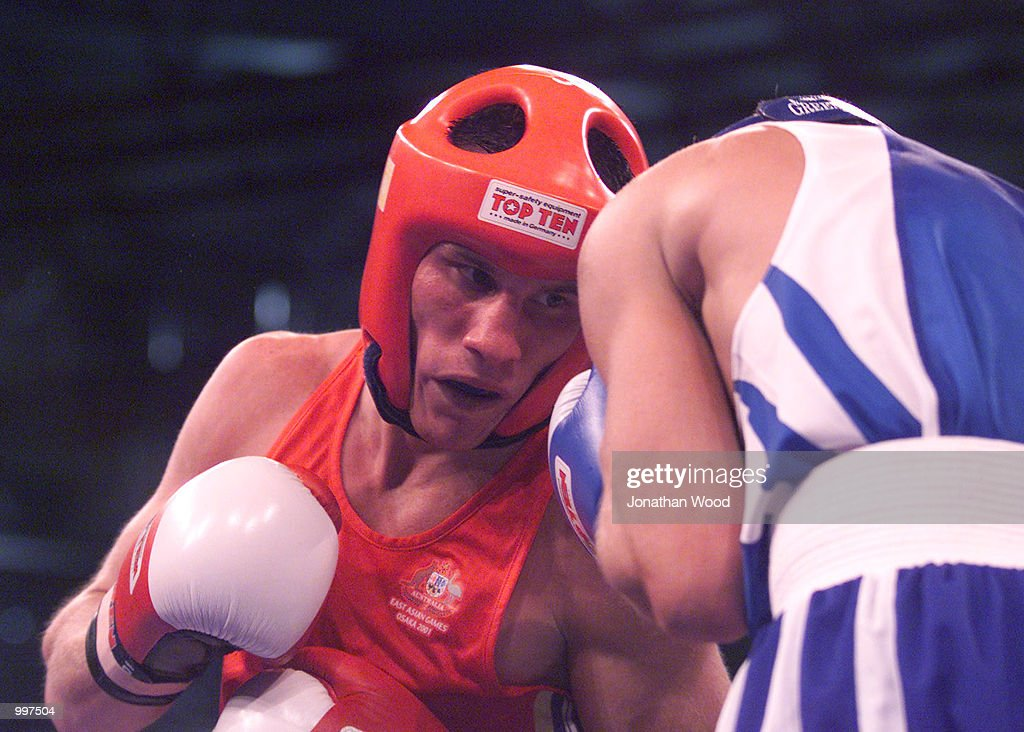 Justin Kane of Australia in action during his bout against Sergei Danylchenko of the Ukraine during boxing competition (54 KG), held at the South Bank Convention Centre, Brisbane, Australia. DIGITAL IMAGE. Mandatory Credit: Jonathan Wood/ALLSPORT