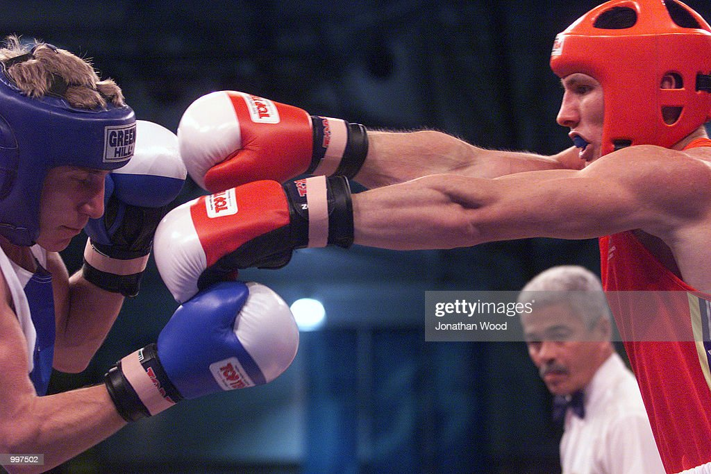 Justin Kane of Australia throws a punch at his opponent, Sergei Danylchenko of the Ukraine during boxing competition (54 KG), held at the South Bank Convention Centre, Brisbane, Australia. DIGITAL IMAGE. Mandatory Credit: Jonathan Wood/ALLSPORT