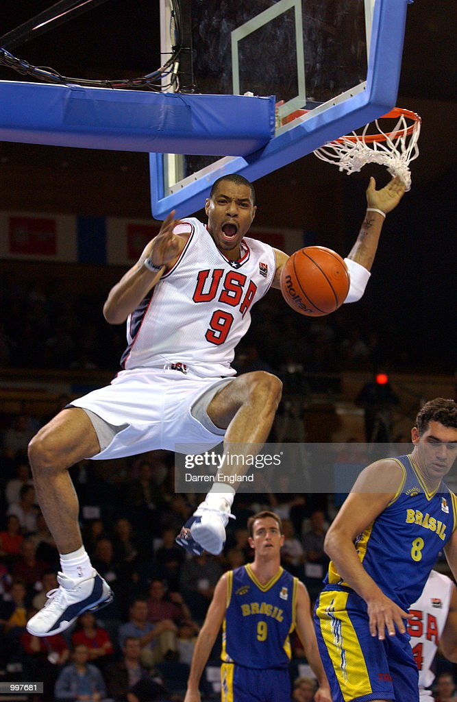 Kenyon Martin #9 of the USA slam dunks during the Basketball semi-final between the United States and Brazil during the Goodwill Games in Brisbane, Australia. DIGITAL IMAGE. Mandatory Credit: Darren England/ALLSPORT