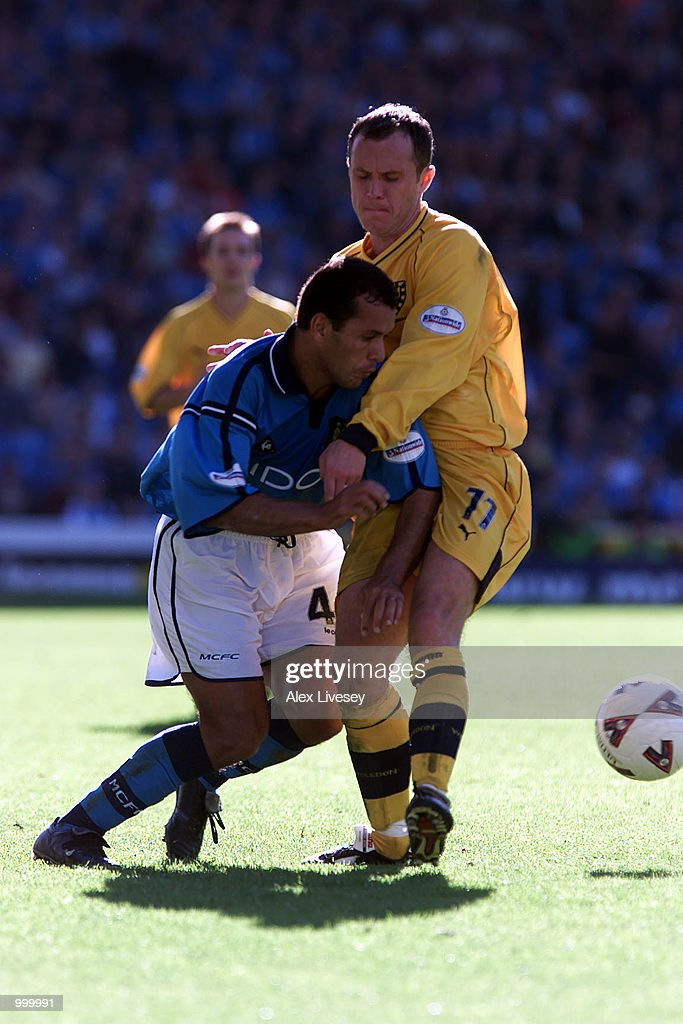Kevin Cooper of Wimbledon holds up Ali Benarbia of Man City during the Nationwide Division One game between Manchester City and Wimbledon at Maine Road, Manchester. DIGITAL IMAGE. Mandatory Credit: Alex Livesey/ALLSPORT