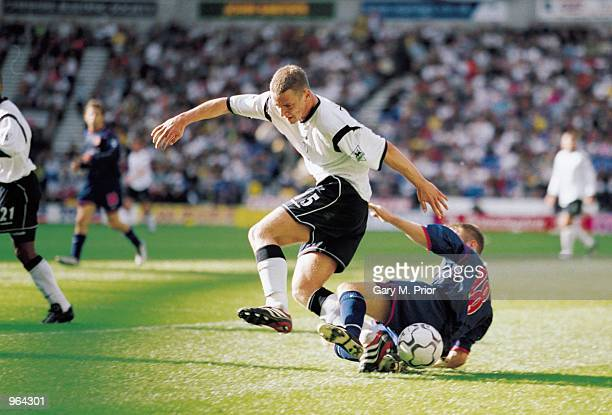 Kevin Nolan of Bolton is tackled by Darren Williams of Sunderland during the FA Barclaycard Premiership match between Bolton Wanderers and Sunderland...