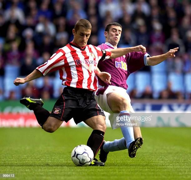 Kevin Phillips of Sunderland is challenged by Mark Delaney of Aston Villa during the Aston Villa v Sunderland FA Barclaycard Premiership match at...