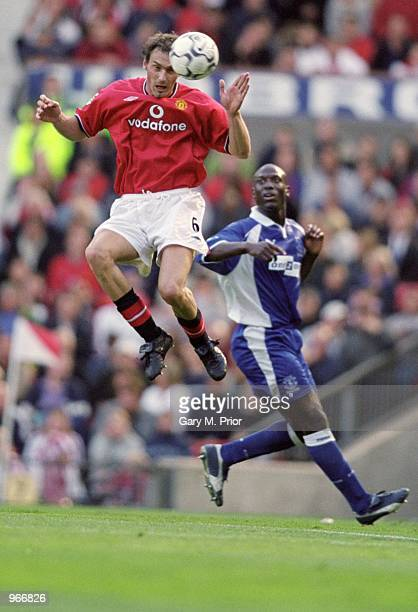 Laurent Blanc of Manchester United wins the header in front of Kevin Campbell of Everton during the FA Barclaycard Premiership match played at Old...