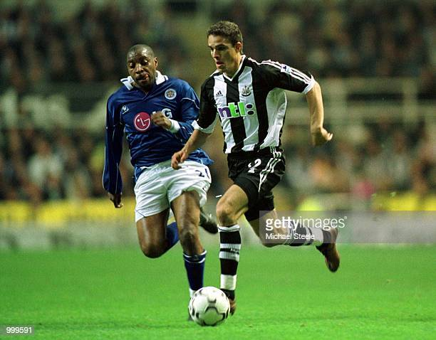 Laurent Robert of Newcastle clashes with Andy Impey of Leicester during the Newcastle United v Leicester City FA Barclaycard Premiership match at St...