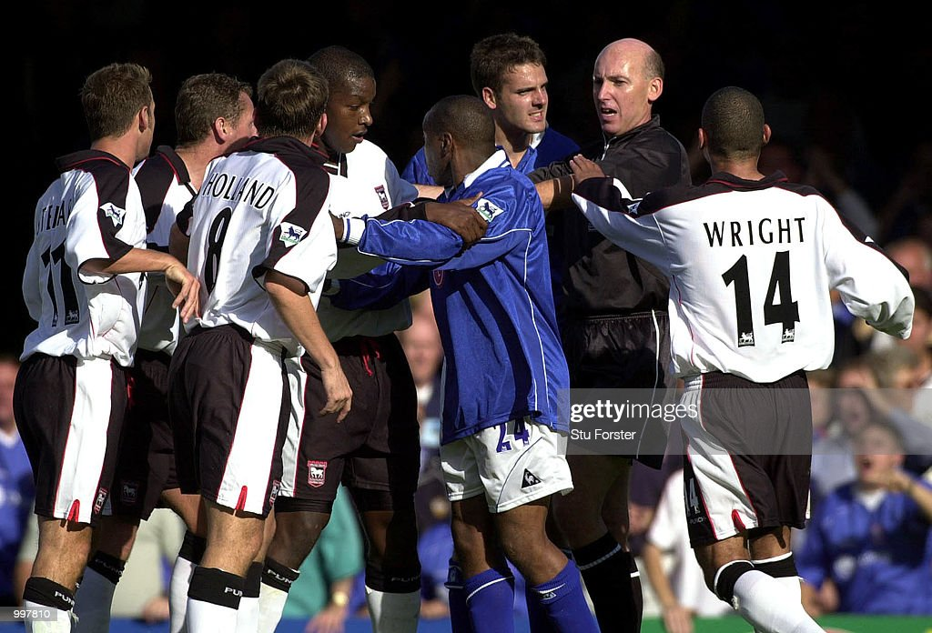 Leicester defender Lee Marshall (third right) makes a point to referee Barry Knight after being sent off during the FA Barclaycard Premiership game between Leicester City and Ipswich Town at Filbert Street, Leicester. DIGITAL IMAGE. Mandatory Credit: Stu Forster/ALLSPORT
