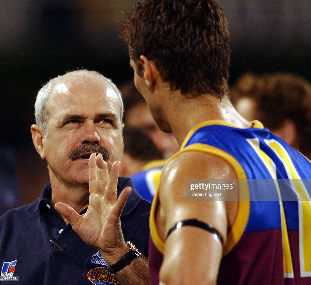 Leigh Matthews (coach) of Brisbane talks to Alastair Lynch #11 at quarter time against Port Adelaide during the AFL Qualifying final match between the Brisbane Lions and the Port Adelaide Power played at the Gabba in Brisbane, Australia. DIGITAL IMAGE. Mandatory Credit: Darren England/ALLSPORT