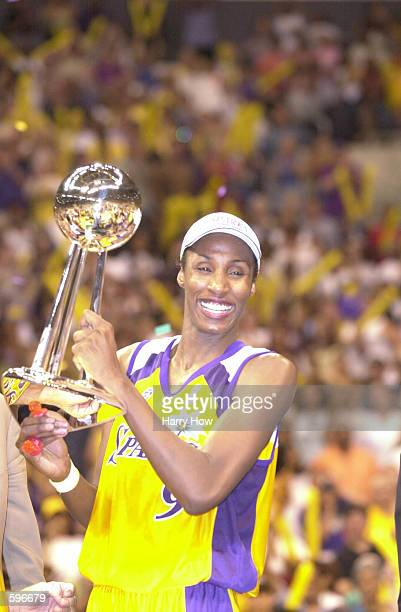 Lisa Leslie of the Los Angeles Sparks holds the 2001 Championship trophy after defeating the Charlotte Sting in game two of the WNBA Finals at...