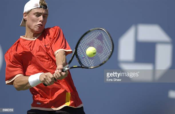 Lleyton Hewitt of Australia returns a shot to Yevgeny Kafelnikov of Russia during the semifinals of the US Open at the USTA National Tennis Center in...