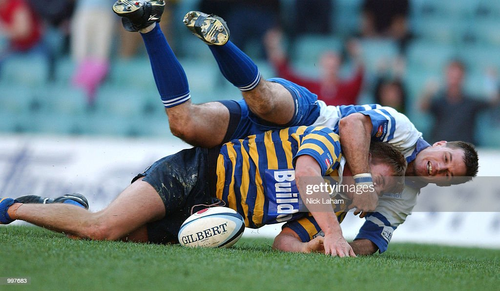 Luke Inman #13 of University scores a try despite pressure from Alan McDonald #13 of Eastwood during the Citibank Mastercard Cup grand final held at the Sydney Football Stadium, Sydney, Australia. DIGITAL IMAGE Mandatory Credit: Nick Laham/ALLSPORT
