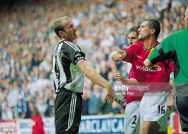 Man Utd Captain Roy Keane takes a swing at Newcastle captain Alan Shearer during the FA Barclaycard Premiership match between Newcastle United and...