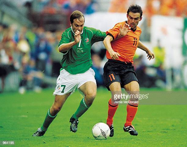 Marc Overmars of Holland is closed down by Jason McAteer of the Republic of Ireland during the World Cup Qualifier played at Lansdowne Road in Dublin...