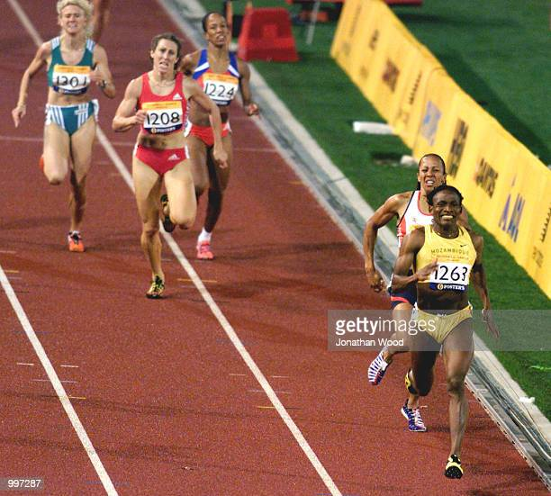 Maria Mutola of Mozambique wins the Womens 800 Metres ahead of Kelly Holmes of Great Britain during the athletics at the ANZ Stadium during the...