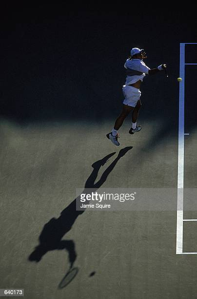 Mariano Zabaleta of Belgium hits the ball during the match against Xavier Malisse of Argentina for the US Open at the USTA National Tennis Center in...