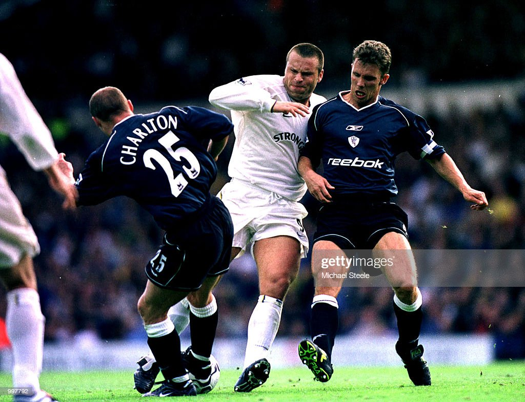 Mark Viduka of Leeds is tackled by Bolton Captain Gudni Bergsson and Simon Charlton during the FA Barclaycard Premiership match between Leeds United and Bolton Wanderers played at Elland Road, Leeds. Mandatory Credit: Michael Steele/ALLSPORT