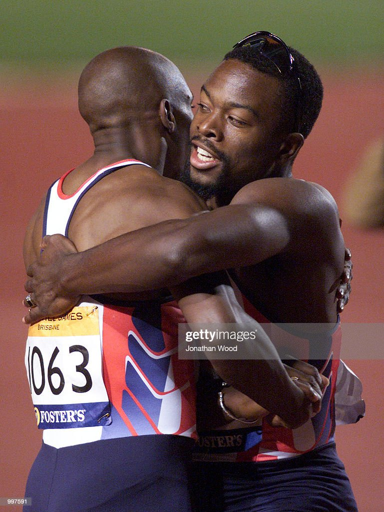 Marlon Devonish (left) and Jonathan Barbour of Great Britain celebrate winning the Mens 4 x 100 Metres Relay during the athletics at the ANZ Stadium during the Goodwill Games in Brisbane, Australia. DIGITAL IMAGE Mandatory Credit: JonathanWood/ALLSPORT