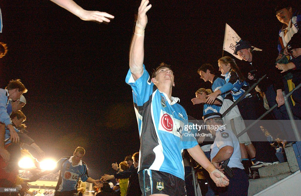 Mat Rogers celebrates the Sharks win with fans during the NRL First Qualifying Final between the Cronulla Sharks and the Brisbane Broncos held at Toyota Park, Sydney, Australia. DIGITAL IMAGE Mandatory Credit: Chris McGrath/ALLSPORT