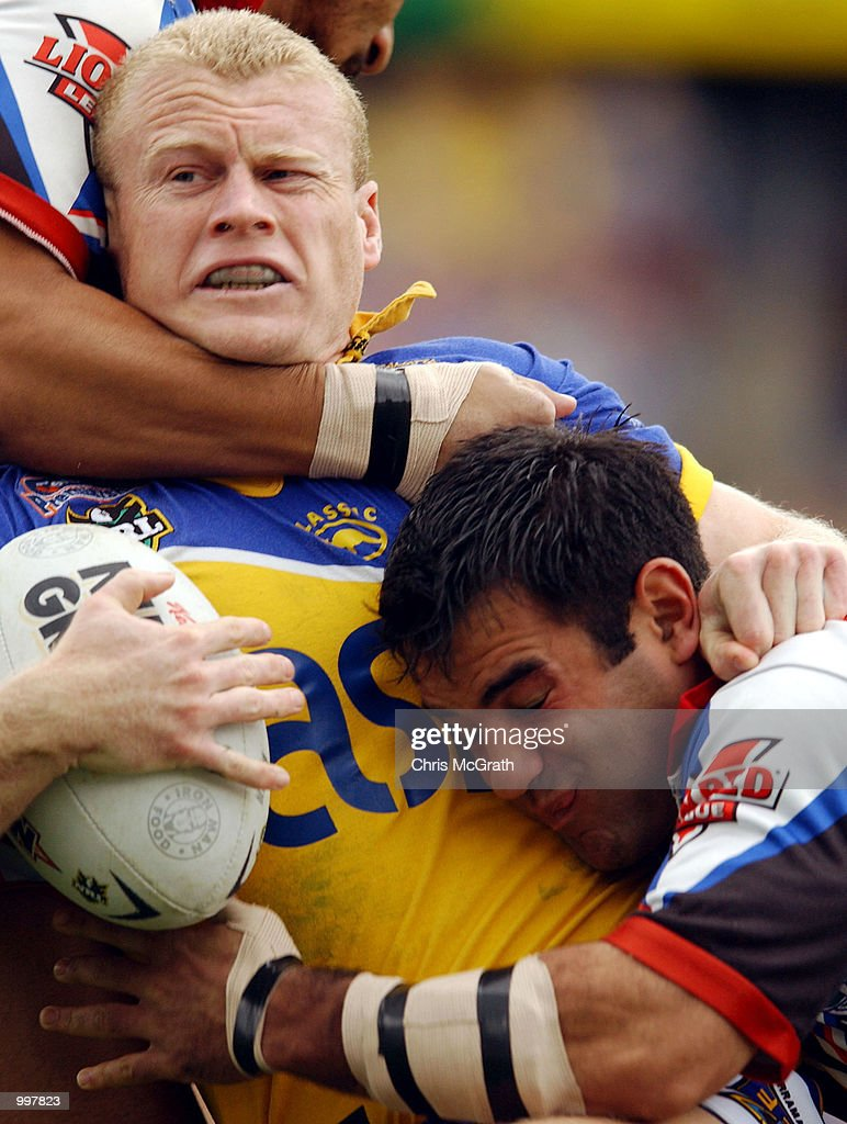 Michael Buettner #6 of the Eels is tackled by Stacey Jones #7 of the Warriors during the NRL fourth qualifying final between the Parramatta Eels and the New Zealand Warriors held at Parramatta Stadium, Sydney, Australia. DIGITAL IMAGE Mandatory Credit: Chris McGrath/ALLSPORT