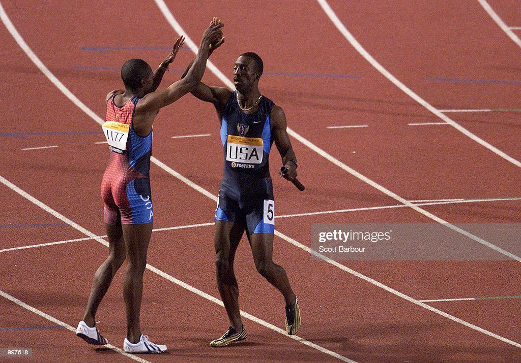 Michael Johnson of the USA (right) celebrates with team mate Antonio Pettigrew as he retires as the USA win the 4 x 400 Metres Relay during the athletics at the ANZ Stadium during the Goodwill Games in Brisbane, Australia. DIGITAL IMAGE Mandatory Credit: Scott Barbour/ALLSPORT