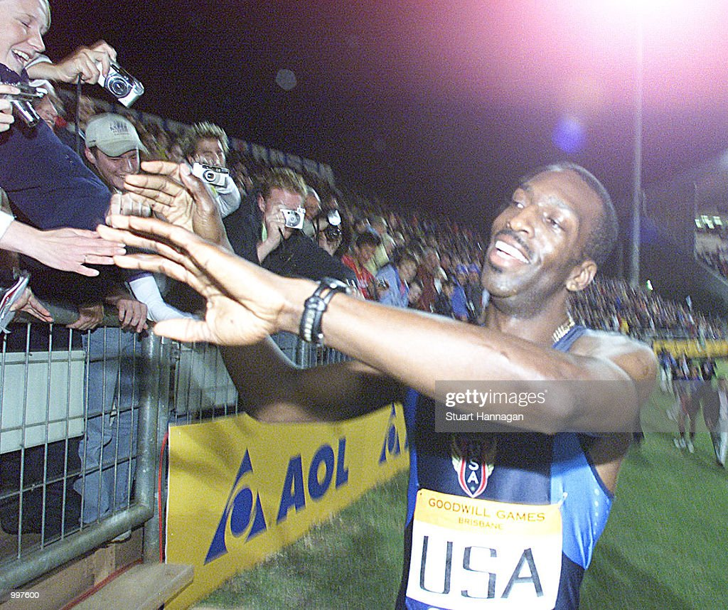 Michael Johnson of the USA completes a lap of honour for the final time as he retires as the USA win the 4 x 400 Metres Relay during the athletics at the ANZ Stadium during the Goodwill Games in Brisbane, Australia. DIGITAL IMAGE Mandatory Credit: Stuart Hannagan/ALLSPORT